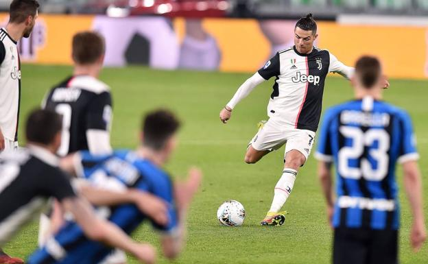 Cristiano Ronaldo kicks off a foul during a clash between Juventus and Inter.